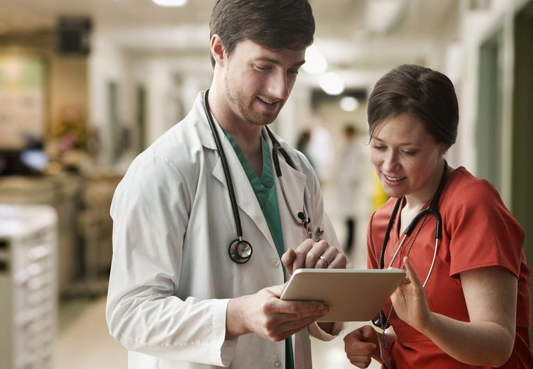 Doctor Discussing on Tablet