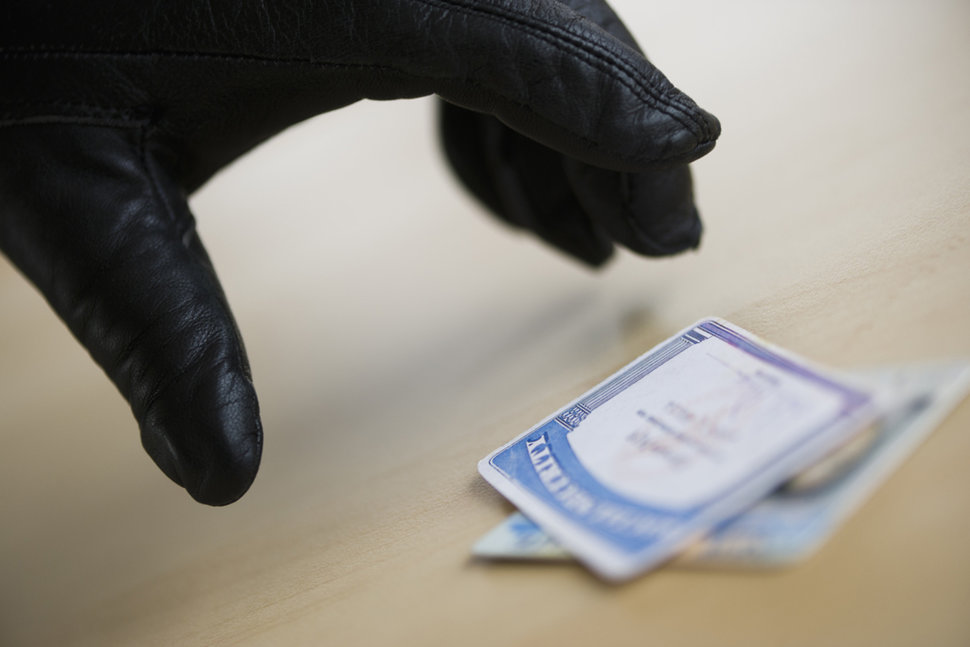 Thief Stealing Identity Cards