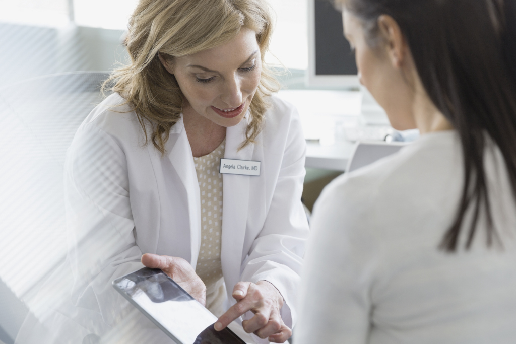 Doctor showing Stats to Patient