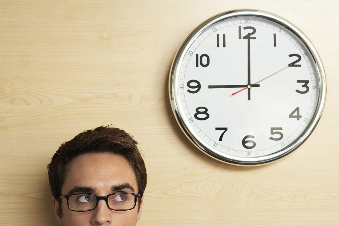 A guy looking at the clock