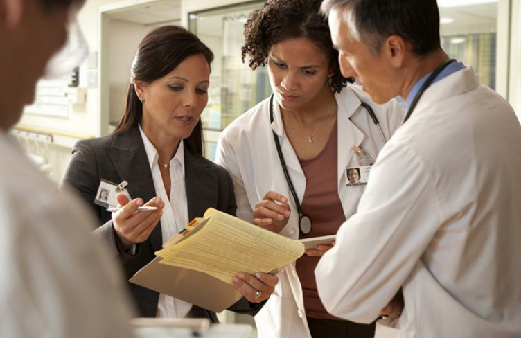 Doctor sharing her Notepad Points with Others