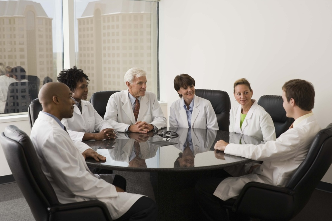 Group of Doctors Sitting Togather