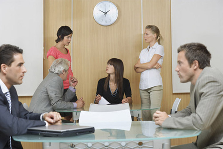 Team discussion in Conference Room