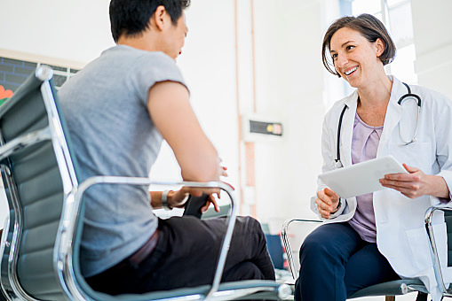 Doctor having Tablet discussion with Patient