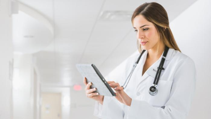 Physician using Tablet Device