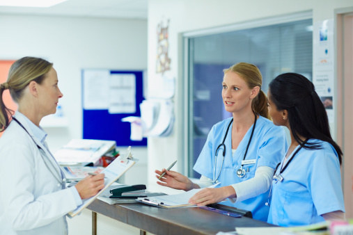Doctor discussing with nurses in hospital