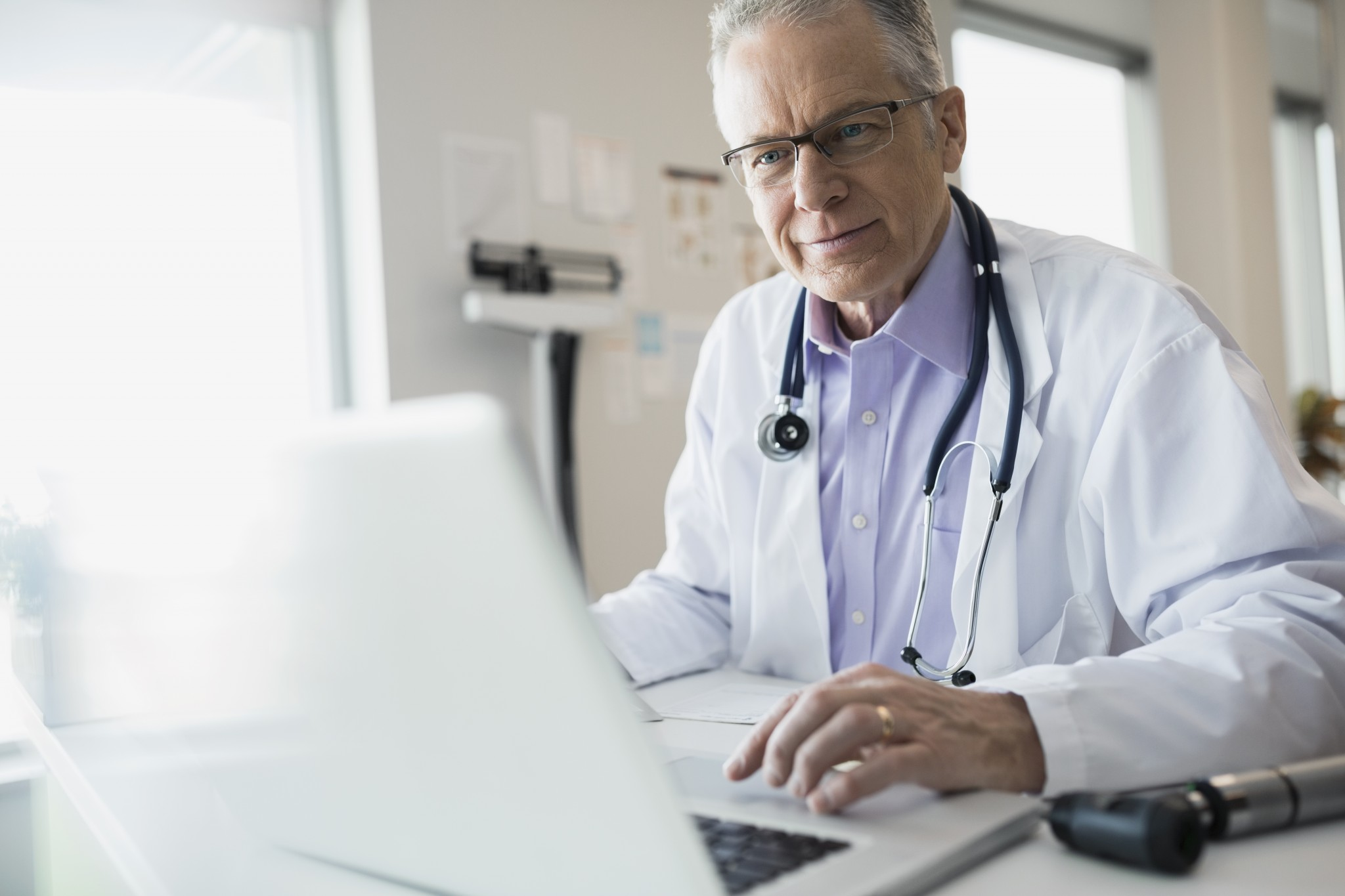 A doctor using laptop