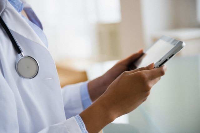 A doctor using Tablet Device