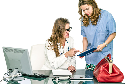 Female doctor reviewing patient's record in ehr software