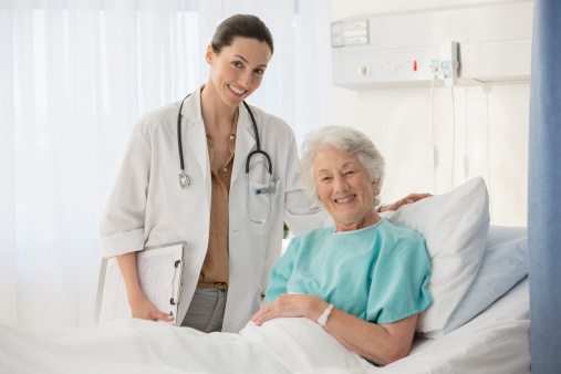 doctor and patient smiling and communicating with each other