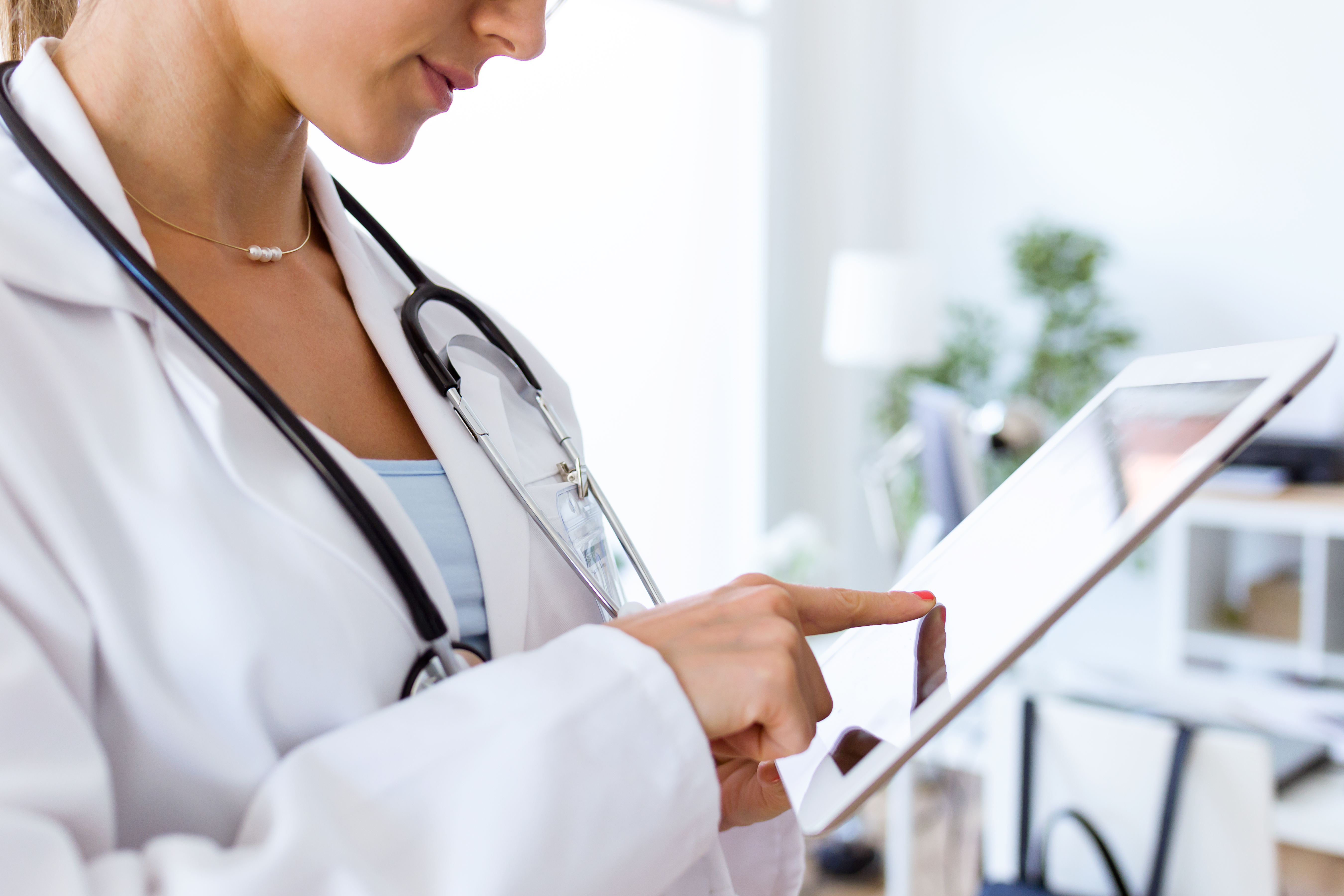 Doctor using Electronic Medical Records Software