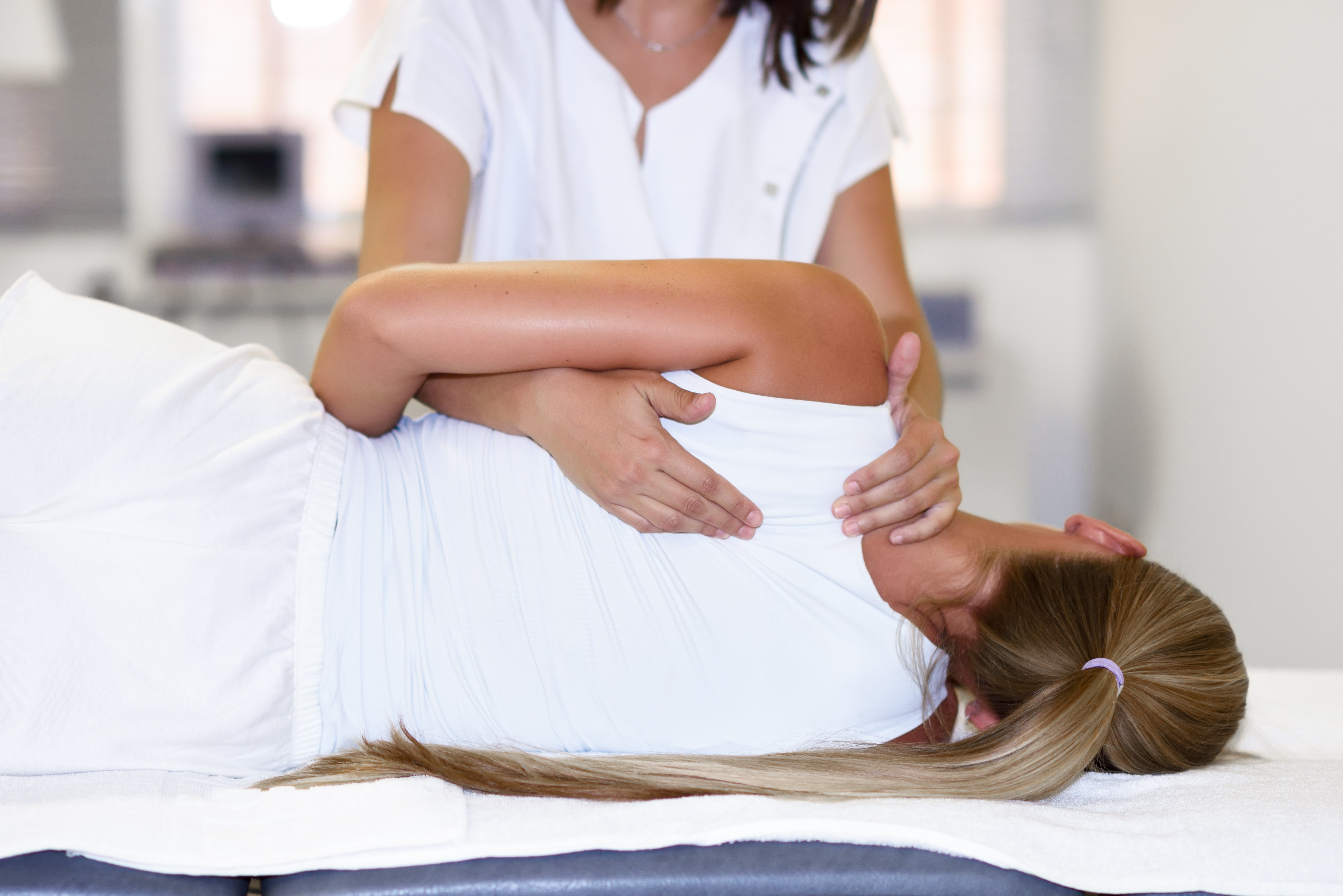 Female Chiropractors Checking Patient