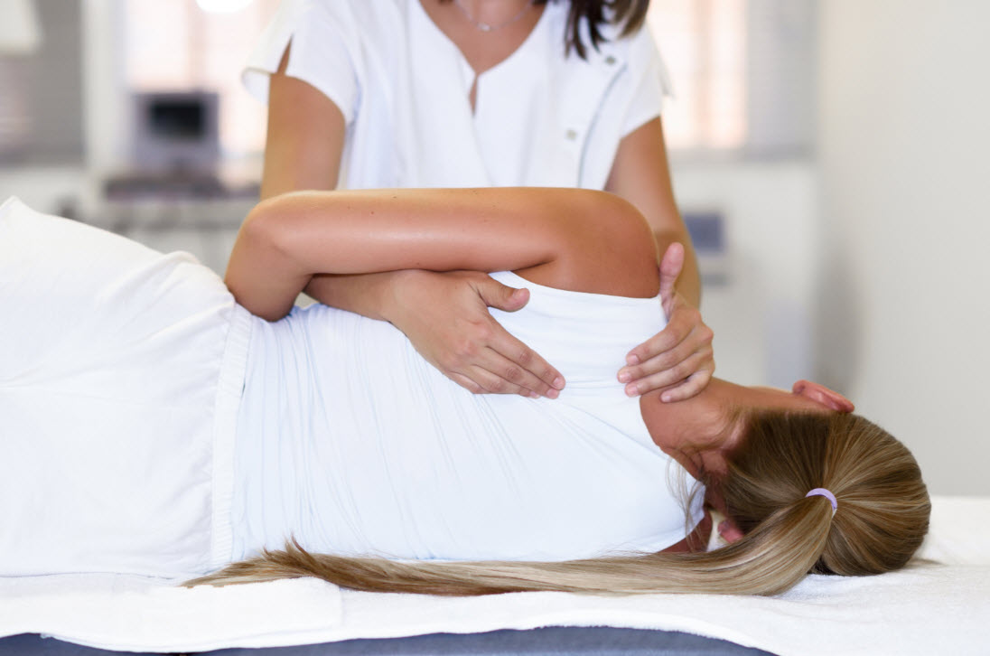 Female Chiropractors Checking Medical Patient