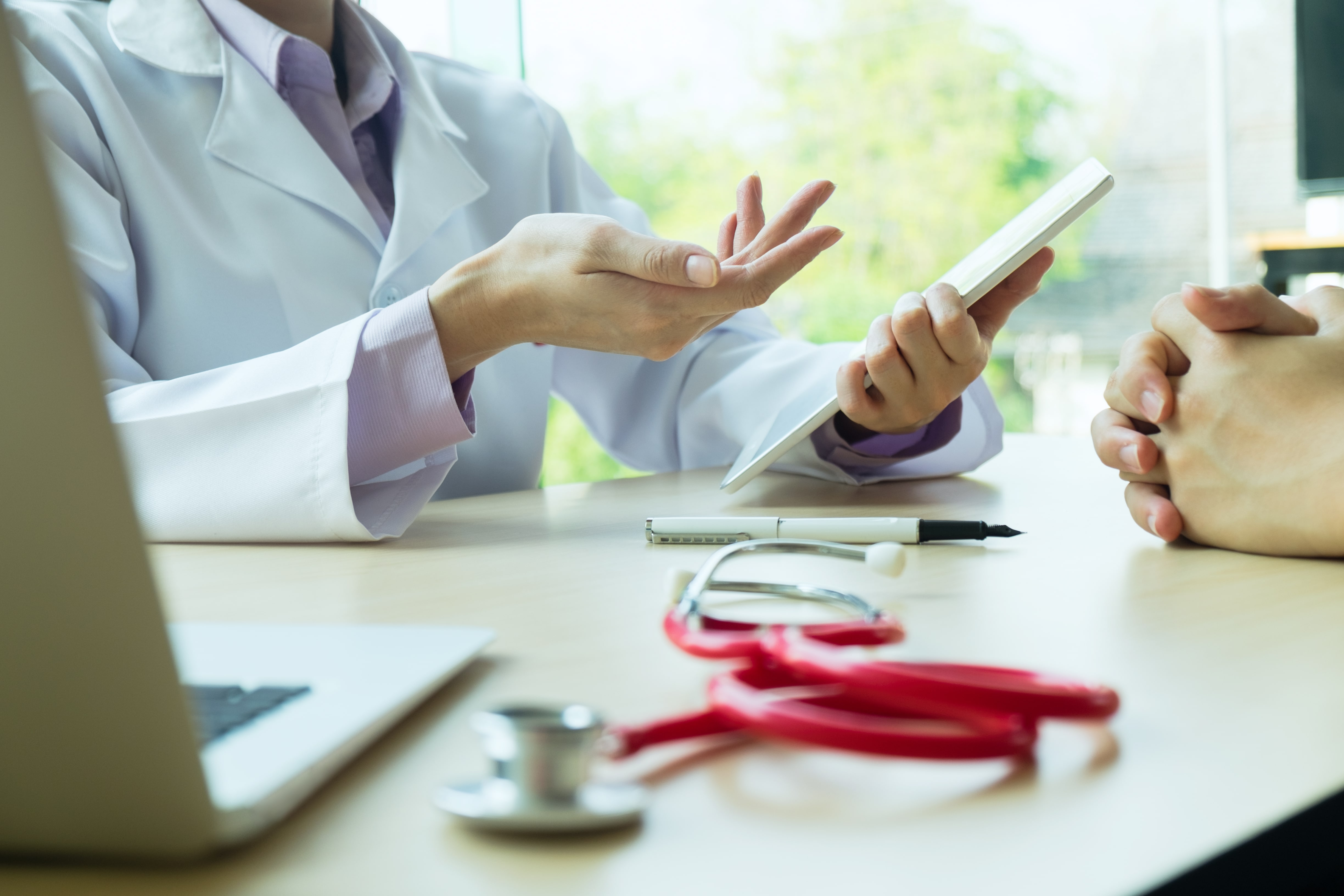Doctor using Mobile Health Application