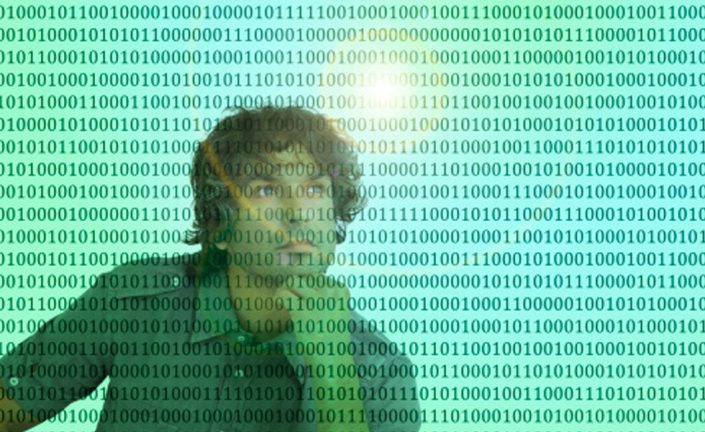 man thinking in front of unusual binary codes